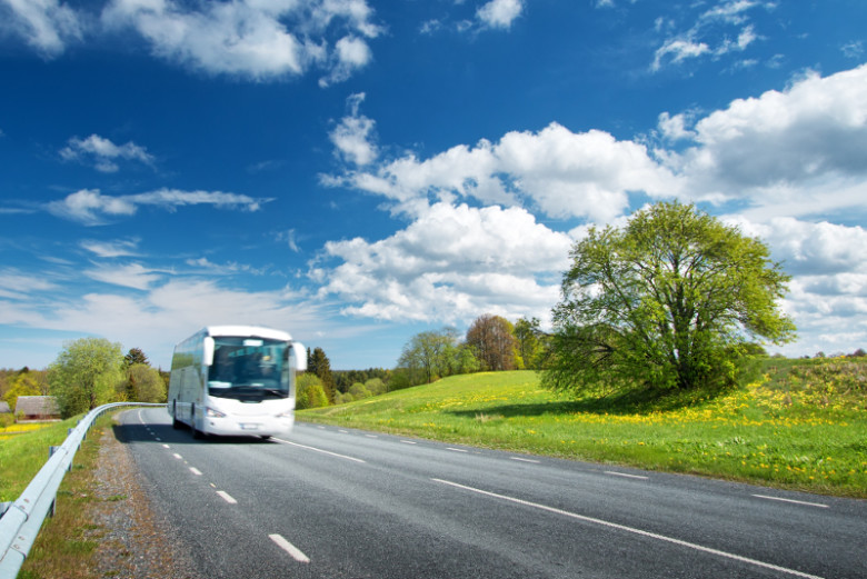 Bus on asphalt road in beautiful spring day at countryside ** Note: Soft Focus at 100%, best at smaller sizes